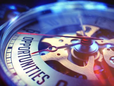 64719982 - business concept: opportunities text. on pocket watch face with close view of watch mechanism. time concept with selective focus and light leaks effect. 3d.