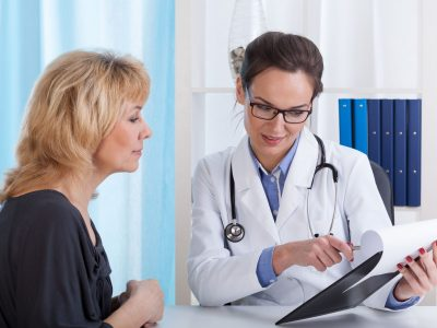 30023853 - doctor showing patient test results in office